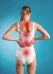 Lumbago. Back pain. Woman with osteoporosis.