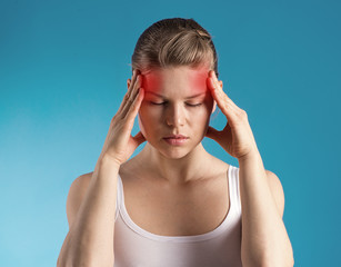Stressed female having migraine shown with red spots