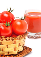 Tomato juice in glass, cherry tomatoes in the basket