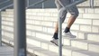Man jogging up the stairs in the city, super slow motion