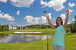 Happy, attractive woman on the golf course