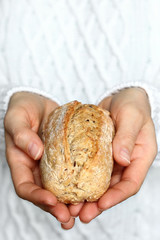 Hand holding bread