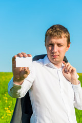man showing a blank card for advertising