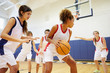 Leinwandbild Motiv Female High School Basketball Team Playing Game
