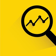 analytics concept, magnifier glass with data chart