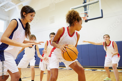 Female High School Basketball Team Playing Game - 66155527