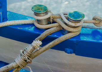 Moored fishing boat with different kinds of rope.