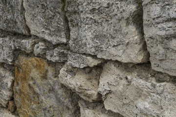 Old masonry of travertine at an angle to the observer