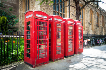 Row of vintage british red telephone boxes