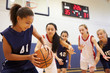Female High School Basketball Team Playing Game - 66159301