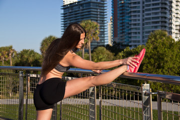 Hispanic female stretching for fitness