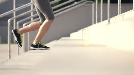 Woman legs jogging up the stairs, super slow motion