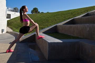 Hispanic girl doing a lunge for flexibility