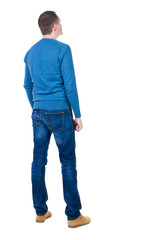 Back view of handsome man in blue pullover.