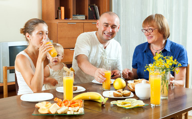 Portrait of nice happy multigeneration family  eating friuts wit