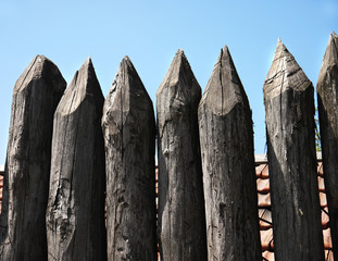 wooden palisade of the protective fence