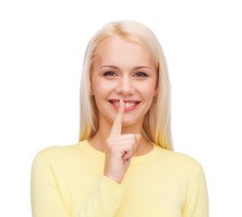 young woman with finger on her lip