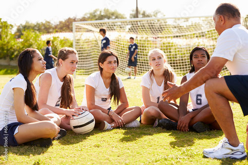 canvas print picture Coach Giving Team Talk To Female High School Soccer Team