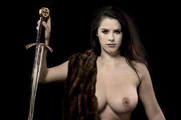 Topless woman warrior.