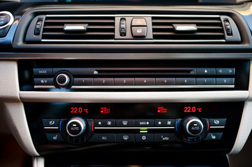 modern car interior with  close-up of air conditioning and venti
