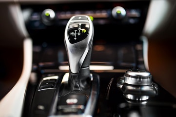 Detail of an automatic gear shifter in a new, modern car