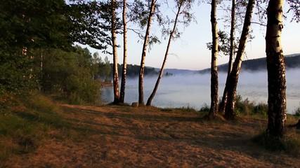 Flight over foggy lake