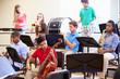 Leinwanddruck Bild - Pupils Playing Musical Instruments In School Orchestra