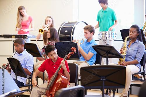 Leinwanddruck Bild Pupils Playing Musical Instruments In School Orchestra
