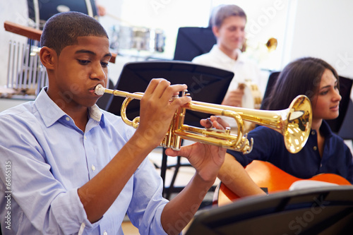 Male Pupil Playing Trumpet In High School Orchestra - 66165135