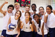 Portrait Of High School Volleyball Team Members With Coach - 66165541