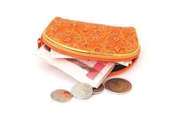 Thai coins and banknote with  orange purse