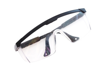 used plastic protection glasses isolated on a white background