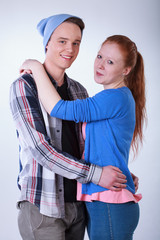 Smiling teenage couple hugging