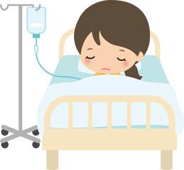 病室のベッドで点滴を受ける女性