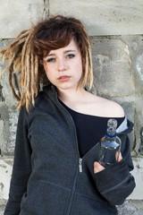 Girl keeping bottle of vodka