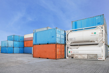 Stack of Cargo Containers and liquid  tank at the docks