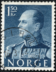 stamp  shows portrait of norwegian king Olav V