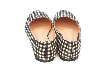 flat lady's shoes with checkered pattern on white background