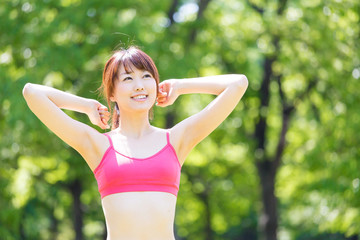attractive asian woman exercise image