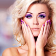 Beautiful  woman with purple nails  and glamour makeup