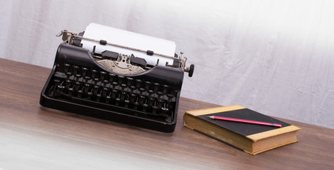 Vintage typewriter and old books