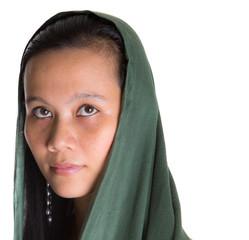 Muslim woman with a green headscarf