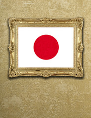 Flag from Japan exposition in gold frame