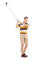 Full length portrait of a joyful man playing golf