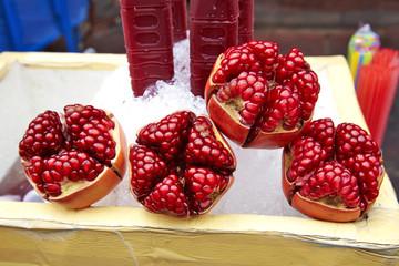 close up many pomegranate on ice