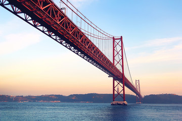 Red bridge at sunset, Lisbon, Portugal. Vintage style