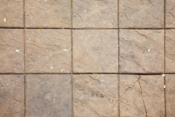 close up large brick floor in sun light