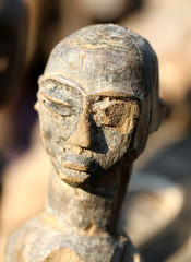 Wooden African mask that represents a woman's face made by hand