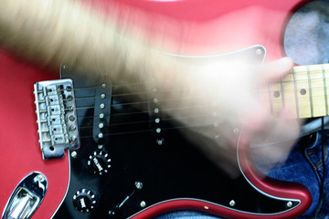 Electric guitar being played
