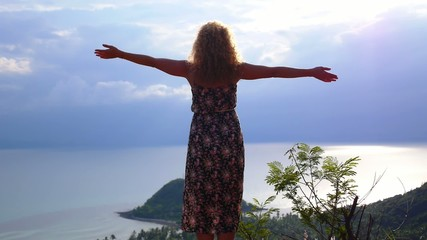 Happy Woman Rising Hands on the Top of Mountain. Slow Motion.